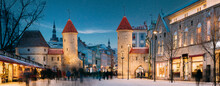 Tallinn, Estonia. Night Starry Sky Above Famous Landmark Viru Gate Gates. Street Lighting In Winter Holiday Evening. Christmas Xmas, New Year Vacation In Old Town. UNESCO Heritage. Panorama. Altered
