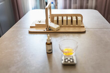 A Soap-maker Weighs Aromatic Oils For Making Cosmetics On A Kitchen Scale. Home Spa. Small Business