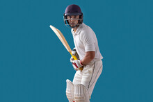 Batsman Ready To Face The Ball, Isolated Over Blue Background
