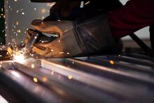 Welders Wear Safety Gloves When Welding. Close Up