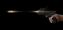 Concept Of Freezing Shot Of A Gun On A Dark BackgroundFreezing Shot Of A Gun On A Dark Background. Concept Gun Club, Gun-shop, Shooting Range