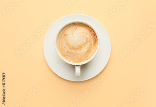 Cup of hot cappuccino on color background - fototapety na wymiar