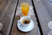 Cup Of Coffee And A Glass Of Fresh Orange Juice On A Wooden Board
