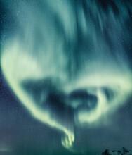 Vertical Shot Of Light Blue Northern Aurora Lights Shaped By A Heart