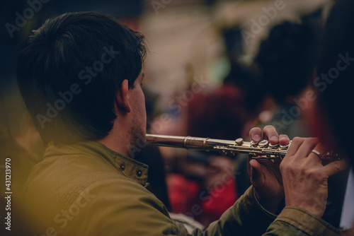 Canvas Print person playing the flute