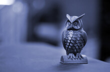 The Green Form In The Form Of A Small Owl Created On 3d Printer Dark Background