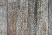 Damaged Grungy Rural Stained Exterior Vertical Oak Ranch Planks Of Country Barn. Old Faded Dirty Ragged Gnarled Surface Wooden Panel Parquet. Rustic Lumber Hard Laths Fence For 3D Siding Grunge Design