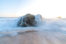Beautiful Shot Of Sea Waves With Smooth Effect Breaking On Coastal Rock