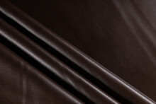 Surface With Folds Of Artificial Leather For Sewing Clothes Dark Chocolate Color, Background