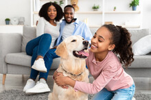 Young Black Girl Hugging Dog Posing At Home