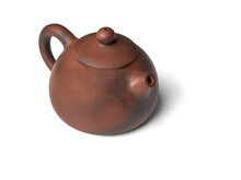 Chinese Orange Clay Teapot Isolated Over The White Background.