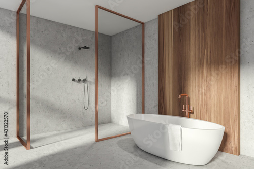 Fototapeta Modern Bathroom interior in new luxury home. Stylish hotel room. Open space area. Concrete wooden walls and floor. Bathtub and Shower cabin. obraz