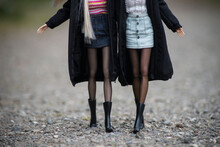 Closeup Of Legs Of Mannequin Dolls Wearing Mini Skirt And Winter Coat Walking In The Street