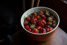 Bowl Of Strawberries In Moody Light