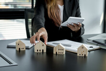 Home Insurance Broker Agent Use Calculators To Calculate Home Purchase Loans According To Loan Documents Received From The Bank. Real Estate Concept.