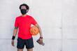 Leinwandbild Motiv Afro athletic man holding basketball ball.