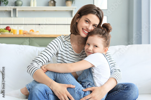 Canvas Print Happy loving mom hugging little daughter, spend time together at home