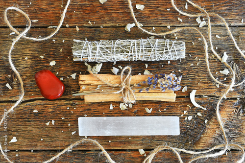 A top view image of healing smudge bundles with selenite and red jasper crystals on a dark wooden table Fotobehang