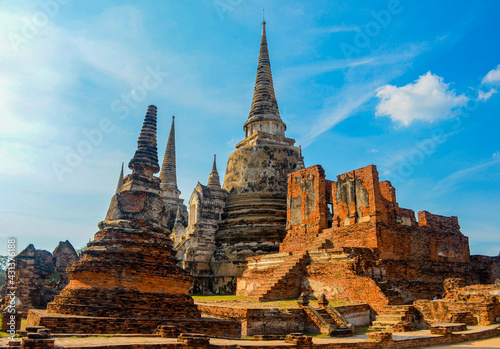 The ruins of the old temple. Historical and cultural ancient architecture in Ayutthaya historical park. Ayutthaya, Thailand - fototapety na wymiar