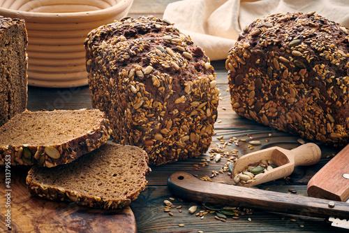 Obraz na plátně Homemade bread on dark wooden table