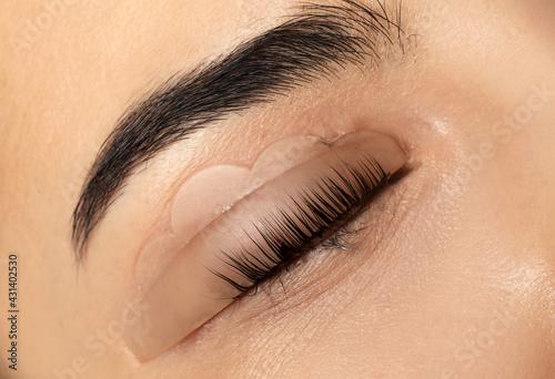 Obraz na plátně Young woman undergoing eyelash lamination, closeup