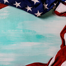 Close Up Of Waving National Usa American Flag On Wooden Background.