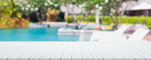 Empty White Ceramic Mosaic Table Top And Blurred Swimming Pool In Tropical Resort In Summer Banner Background - Can Used For Display Or Montage Your Products.