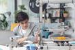 Leinwandbild Motiv Smart student learning 3D printing at home