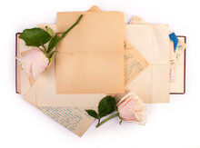 Open Old Book And Roses With Copy Space Isolated On White Background.