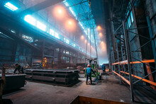 Metallurgical Plant Or Steel Factory, Large Workshop Interior With Industrial Cranes And Workers, Heavy Industry, Iron And Steelmaking.