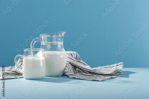Carta da parati Fresh milk for breakfast in the sunshine on a blue background