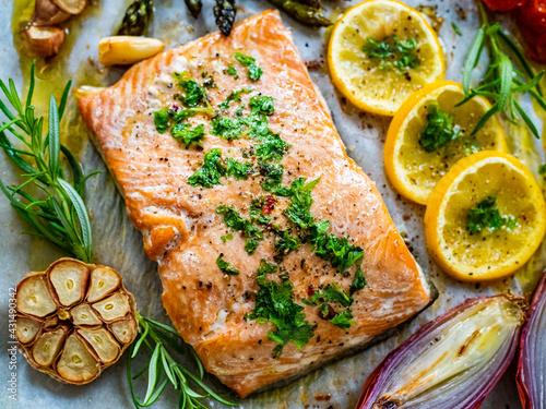 Fotografie, Obraz Sheet pan dinner - roasted salmon steak with asparagus, lemon ,rosemary, tomatoe