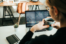 Woman Working With Stock Market Using Laptop, Analyzing Trading Data