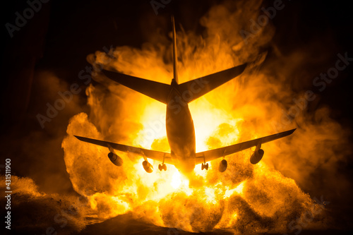 Air Crash. Burning falling plane. The plane crashed to the ground. Decorated with toy at dark fire background. Air accident concept. - fototapety na wymiar