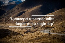 """Inspirational Quotes: """"A Journey Of A Thousand Miles Begins With A Single Step"""" Typography With Nature Background"""
