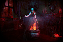 Witch Conjures Over Cauldron