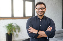 Headshot Of Skilled Hindu Male Employee Standing With Arms Crossed In Modern Office, Successful Confident Mixed-race Man Wearing Eyeglasses And Smart Casual, Business Portrait Of Indian Entrepreneur