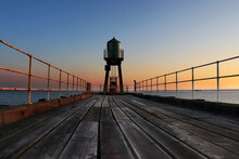 Sunrise At West Pier In Whitby, Yorkshire, UK