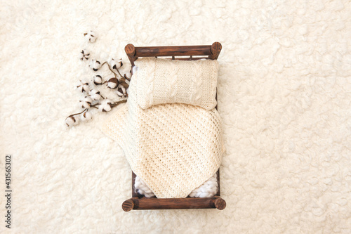 Newborn photography background - rustic wooden bed  with white chunky blanket, k Fototapeta
