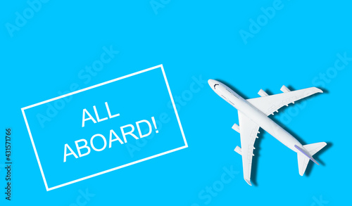 Flat lay design of travel concept with plane on blue background with copy space - fototapety na wymiar
