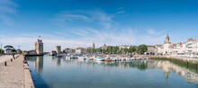 Panorama Of The Old Harbor Of La Rochelle, The French City And Seaport On A Sunny Day. Beautiful Blue Sky.