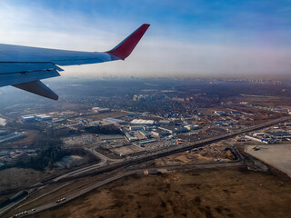 View of the land surface from a window of the plane flying at big height, Moscow region