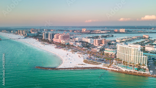 Panorama of city Clearwater Beach FL. Summer vacations in Florida. Beautiful View on Hotels and Resorts on Island. Blue color of Ocean water. American Coast or shore Gulf of Mexico. Sky after Sunset.