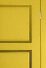 Fragment Of New Stylish Painted Yellow Wooden Door