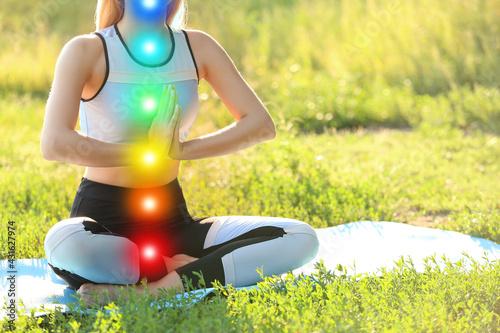 Fényképezés Beautiful young woman practicing yoga in park