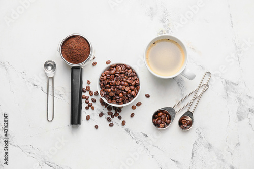Obraz Composition with cup of coffee, beans and powder on light background - fototapety do salonu
