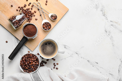 Composition with cup of coffee, beans and powder on light background - fototapety na wymiar