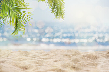 Abstract seascape with palm tree, tropical beach background. blur bokeh light of calm sea and sky. summertime vacation background concept.