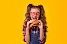 Happy Girl Biting Delicious Hamburger