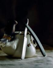 Studio Shot Of Shaving Brush, Soap And Cut Throat Razor